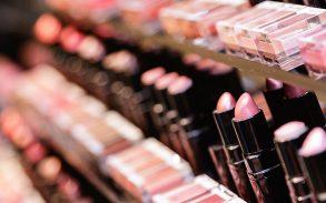 A row of lipsticks in a makeup shop