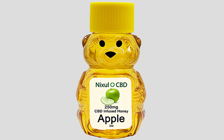bottle of apple honey with cbd shaped like a bear.