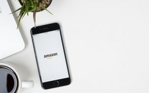 mobile phone on a desk with the amazon app opened.