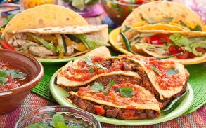 Colorful Traditional Mexican food dishes: various fajitas, quesadillas