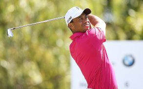 Tiger Woods tees off the sixth hole during the third round of the BMW Championship.