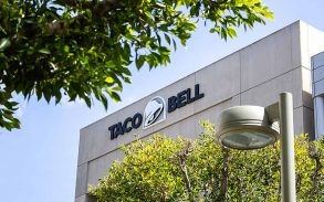 A building front sign for the Taco Bell headquarters
