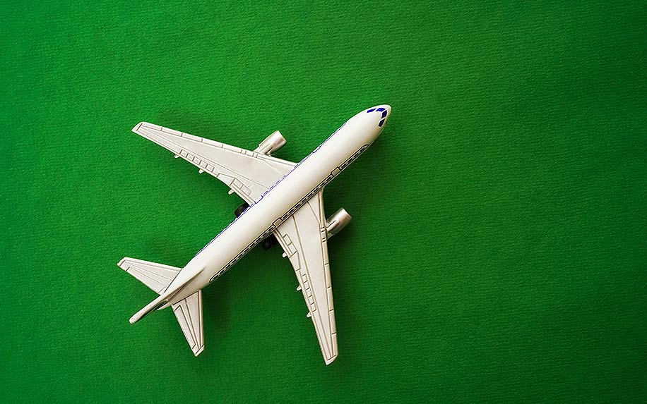 model of plane on green textured paper background