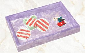 Artistic cartoon visual off imagery from Edie Parker, Purple tray coasters and keys.